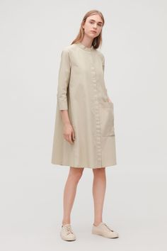 68fba46092 This casual shirt dress is made from crisp woven cotton. An A-line fit with  ¾ sleeves