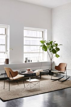 Team dark wood floors with white walls to showcase designer furniture.  (scheduled via http://www.tailwindapp.com?utm_source=pinterest&utm_medium=twpin&utm_content=post139316535&utm_campaign=scheduler_attribution)