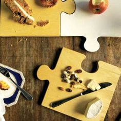 Wooden Jigsaw Serving Board  The wooden Jigsaw Serving board is perfect for an afternoon of cheese and wine.    • Each Serving board piece is exactly the same. When 4 pieces are placed together they join to make a completed square puzzle.    • They are the same size as the Ceramic Jigsaw plate, and so you can mix and match puzzle combinations of wood grain and ceramic, forming an eye catching puzzle of possibilities.