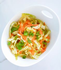 6 small head of cabbage or large head 3 large carrots 1 handful of cilantro, chopped 3 stalks of green onions, sliced 3 garlic cloves, diced Carrot Slaw, Green Onions, Cilantro, Carrots, Side Dishes, Healthy Recipes, Healthy Meals, Cabbage, Low Carb