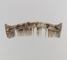 Comb, 6th century, made in Niederbreisig, Frankish, Bone with Iron Pins; Dimensions: Overall: 6 1/2 x 1 3/4 x 11/16 in. (16.5 x 4.5 x 1.7 cm)