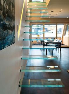 cool suspended  'glass' stairs - click to see the rest of this home.
