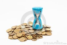 Coins and hourglass isolated on a white background