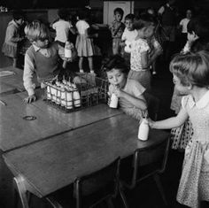Free morning milk at Courtland Primary School, Mill Hill: 1959 by Henry Grant. Museum quality art prints with a selection of frame and size options, and canvases. Museum of London 1970s Childhood, My Childhood Memories, School Memories, Childhood Images, Vintage Milk Bottles, Nostalgia, Foto Madrid, Vintage School, Thing 1