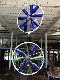 Bikes wheels at For the Birds....awesome idea for all the blue bottles in my garage we didnt use for the wedding!