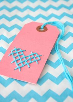 Cross stitch name tags that can double as ornaments :D - Sketch on graph paper, then poke holes through the graph paper onto your cardstock and stitch the pattern.