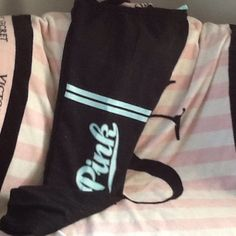 BNWOT VS PINK CAMPUS PANTS BNWOT VS PINK CAMPUS PANTS ordered on-line oversized fit black with grey specks light blue stripes and PINK written on the leg 2 side pockets 1 back pocket elastic tie waist elastic pant bottoms full length pants NO TRADES NO OTHER APPS will price drop PINK Victoria's Secret Pants