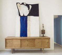 eclectic credenza + modern art...represents individuality & good design style.