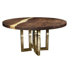 Elegant Round Table Rests on a Gorgeous Series of Brass Legs | From a unique collection of antique and modern dining room tables at https://www.1stdibs.com/furniture/tables/dining-room-tables/