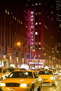 Radio City Music Hall With Yellow Cab In New York City NYC Photographic Print by Philippe Hugonnard at Art.com