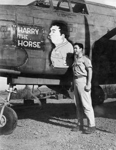 USAAF 3rd Bomb Group airman posing alongside of the nose art of A-20 Havoc aircraft 'Harry the Horse', Nadzab Airfield, Australian New Guinea, early 1944