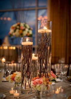 particular centrepiece uses roots instead of petals underneath the candles / http://www.deerpearlflowers.com/twigs-and-branches-wedding-ideas/2/