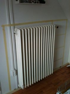 How to build a radiator cover Taping off the area outline is a great way to begin getting a feel for the sense of space you'll be covering around the heater. Refurbished Furniture, Home Furniture, Wall Heater Cover, Diy Radiator Cover, Ikea, Console, Radiators, Home Projects, Decorating Your Home