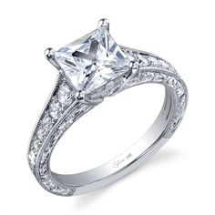 2CT princess cut central diamond, surrounded by 0.36CT of accent diamonds in an engraved 18K white gold setting.