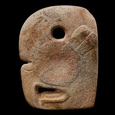 Ceremonial Hacha Representing a Macaw, Maya. Mexico. The hooked beak is perforated in its centre. The nostrils are marked by a groove.
