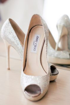 I would love to buy these just to have a pair of Jimmy Choo shoes. I don't wear heels and I'm not obsessed with shoes but. They're Jimmy Choo! (oh, and also BEAUTIFUL) Silver Wedding Shoes, Wedding Heels, Silver Shoes, Sparkly Shoes, Glitter Shoes, Sparkle Wedding, White Glitter, Ivory Wedding, Silver Sparkly Heels