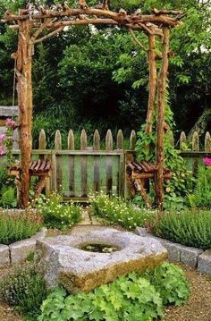 A garden grape vine arbor idea
