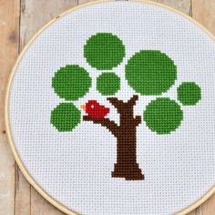 I might have to revive my middle school hobby of cross stitching after finding such cute patterns.  It's not just Precious Moments anymore!