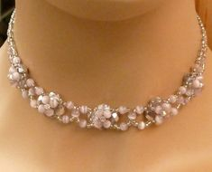 This elaborately crafted pearl necklace sets real highlights. It is simple yet festive and is suitable for both leisure and festive events. The necklace is made of facetted pearls in silver color, seed pearls in clear silver and tigers eye pearls in pink. The necklace has a length of 39 cm and adjustable up to 44 cm. Please mete before your neck circumference as the necklace should fit as close to the neck. Goods will be shipped immediately after payment. Shipments to the USA and Canada…