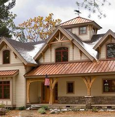 Want to change the posts on our front porch to look like this.  Timber Frame House Preview