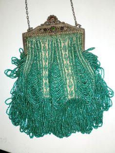 1920's Beaded bag - https://www.1stdibs.com/fashion/accessories/handbags-purses/1920s-beaded-frame-evening-bag-turquoise-beads/id-v_69403/