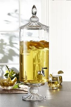 Elegant Cylinder Glass Footed Beverage Dispenser. Ask about our engraving options!