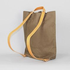 Shove in all the things...put it on your back. Cool. 700_schoolbagkhaki6-grande