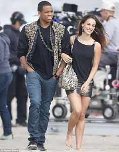 Tristan Wilds and Jessica Lowndes on set looking absolutely adorable in their matching outfits. #90210 #cheetah #blackandgold