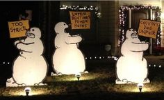 Cute Calvin and Hobbes Christmas decorations in the front yard
