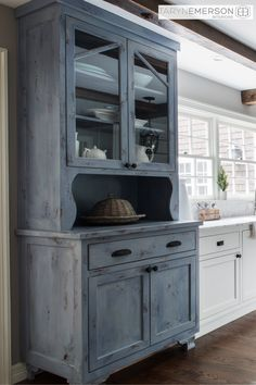 What a statement piece for this timeless farmhouse kitchen! This blue aged cupboard is the perfect furniture piece to make a bold statement in your dream kitchen. Click here to check out more photos from this gorgeous farmhouse kitchen. #HGTV #TimelessKitchenDesign #DreamKitchen #LakeOswegoInteriorDesign #TarynEmersonInteriors #Farmhouse #FarmhouseKitchen #Portland