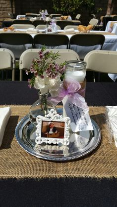 Mariana's Baptism Centerpiece. So easy and cheap. Dollar tree candle, tray, vase (2 per pack @ 99cent store). Picture frame from amazon.