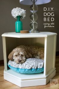 This is a dog bed made from an octagon end table with cabinet doors.  Remove the cabinet doors, fill holes in with wood putty, and paint. You can find these types of end tables at an estate sale any given weekend. Super cute and can still be used as an end table!