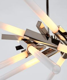 Based on Lindsey Adelman's Agnes collection, Astral Agnes reconfigures the modular units of the original series into radial, symmetrical forms that channel galactic phenomena and space travel. Roll Hill, Lighting Companies, Led Chandelier, Metal Finishes, Polished Nickel, Modern Lighting, Ceiling Fan, Lights, Denver