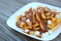 Big Bears Wife: Mozzarella Pearl Poutine (Fries and Gravy)