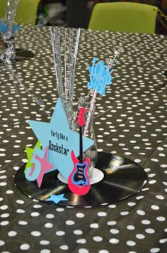 Centerpieces I made with old records, guitars, stars, etc for a Rockstar birthday. See more at Live It Up Parties on Facebook