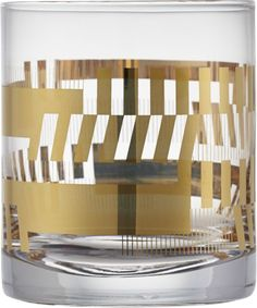 metallic mixer.  Graphic cocktailer is ready to entertain in slick gold.  Deconstructed plaid aligns a geometric play on clear modern glass that toasts with substantial heft.  Mix metallics with platinum plaid double old-fashioned. Clear glassGold decal designHand wash.