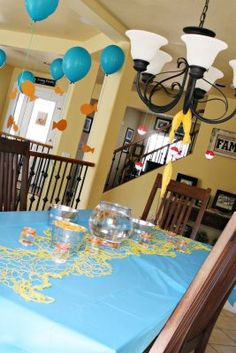 This is cute. I would love to get Caleb a fish for his birthday and have it set out on the table like that