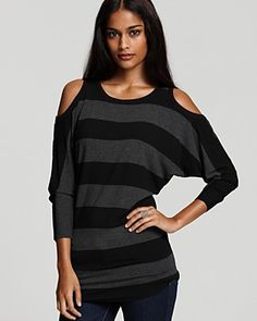 Love the cut-outs on the shoulders..looks like this shirt would go well with black jeans =)  Retail--$81.00
