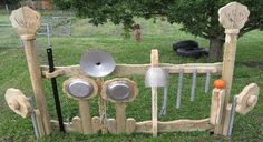 Musical outdoor area for your young ones to explore making music.  Although I couldn't find the site that this came from (no longer exist) here is an awesome site for outdoor play area. https://www.naturalplaygroundsstore.com/