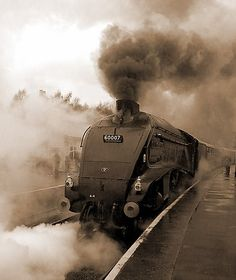 """LNER A4 pacific locomotive 4498/60007 """"Sir Nigel Gresley"""" in later British Railways livery and BR number."""