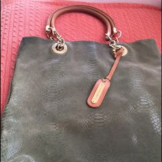 "Cynthia Rowley Handbag This bag has been greatly loved, but is still in good condition.it's a beautiful green snakeskin with  camel leather handles and beautiful gold accentsIt is sizeable (15""x14"")with ample interior space; (1) large interior zipped pocket and (2) small open pockets. FREE WALLET WITH PURCHASE  Cynthia Rowley Bags"