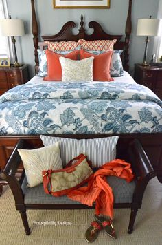 Master Bedroom for Summer with complementary colors, blue and orange. The faux coral crewel pillow was the inspiration for the whole design. Via Housepitality Designs.