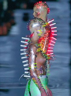 Givenchy Fall-Winter 1999 Flashing LEDs mounted on two transparent PetG body-hugging bodices, vac-formed from plaster body-cast. Concept by Alexander McQueen designed-made by Studio van der Graaf London. Models wear battery packs on their backs. Weird Fashion, Look Fashion, Fashion Art, Fashion Design, Tribal Fashion, High Fashion, Alexander Mcqueen, Van Der Graaf, Body Cast