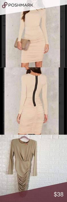 #47💗🆕 sugar kisses mini dress It's all like sugar. Our Sugar Kisses Dress features a round neckline, full beige lining, asymmetric hem, and ruche detailing through sides. By Nasty Gal. Shoulder pads. Fitted. Ruching. Content. 95% Polyester. 5% Spandex. Machine wash cold. Made in U.S.A. Color: natural Nasty Gal Dresses Long Sleeve