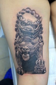 Wicked black and grey fu male fu dog tattoo.