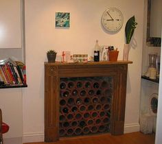 wine racks in fireplace | Working Your Non-working Fireplace | Apartment Therapy
