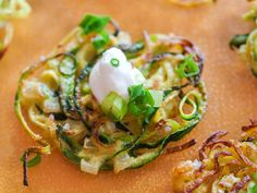 Zucchini Latkes : Substitute spiralized zucchini for the potatoes in your favorite potato pancake recipe. These are topped with scallions and Greek yogurt for a summery twist on a cold-weather favorite.