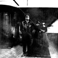 Tsar Nicholas II at the Standart. In the background Tsarina Alexandra and Anna Vyrubova.