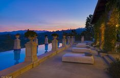 Stunningly striking: The pool and spa defines the outdoor entertaining space as quintessen...