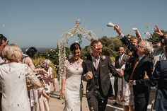 Confetti Moment | Bride in Pronovias Princia Lace Gown & Jacket | Outdoor Wedding at The Haven Hotel in Southern Ireland | Jason Mark Harris Photography